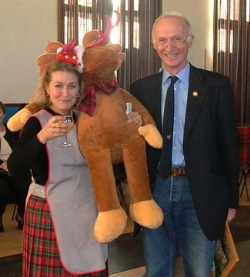 John Mackison presents Elisabeth Matell  with the toy reindeer which she has won in the raffle.