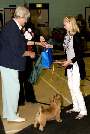 Best Junior Handler receives her prize from the judge.