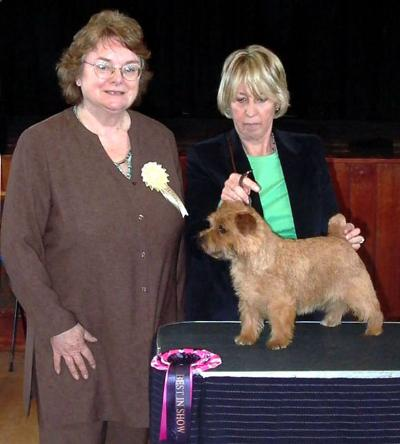 BEST IN SHOW & BEST BITCH KRISMA JELLYBEAN with judge Annette Penny  and owner Dot Britten