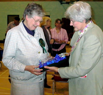 President Mrs Cherry Howard thanks the judge  on behalf of the club  and presents her with a glass decanter  engraved with the head of a Norfolk.